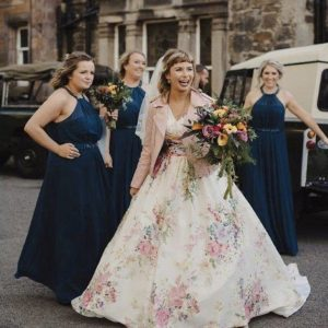 floral wedding dress with bridesmaids