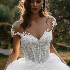 intricate lace bodice with plain full skirt wedding dress